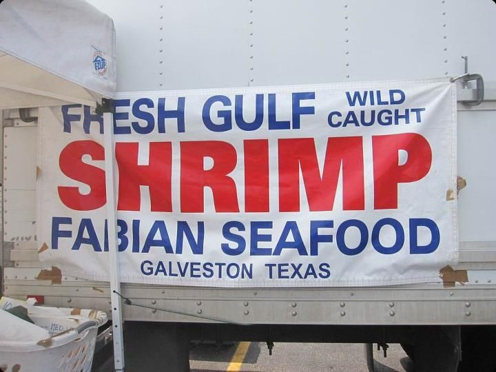 banner on side of a shrimp truck